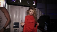 Dj girl in red dress dance at turntable in nightclub with mc man. Wave hair Stock Footage