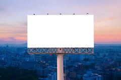 Blank billboard for advertisement with sunrise in city Stock Photos