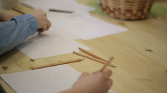 Young people at a drawing lesson using pencil sketching on sheets over wooden Stock Footage