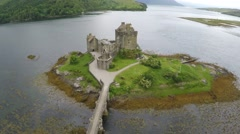 Aerial drone view of the Eileen Donan Castle in Scotland Stock Footage