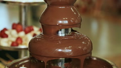 Chocolate fountain hot liquid flowing down tower pyramid Stock Footage