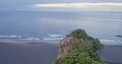 Aerial drone over cliff reavealing karekare beach, Auckland, New Zealand Stock Footage