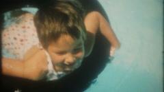 3456 happy children swim & play in the backyard pool-vintage film home movie Stock Footage