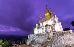 Pagoda of Phu Si Temple at twilight time in Luang Pra bang, Laos - stock photo