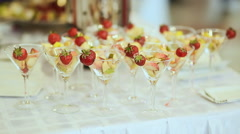 Fruit in a glass with strawberry on a white table. Celebration Stock Footage