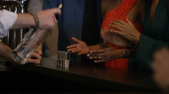 4K Bartender pouring shots for group of friends partying in city bar. Stock Footage