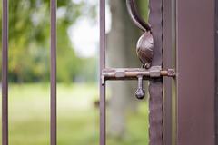Rusty metallic latch - stock photo