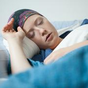 Young woman having tumor sleeping Stock Photos