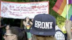 Bronx hat and LGBT rainbow flag on Gay Pride day in NYC in 1080 HD Stock Footage