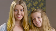 Portrait of a teen girl and her younger sister Stock Footage