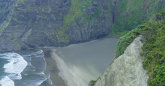 Aerial drone over rocky coastline at karekare, Auckland, New Zealand Stock Footage