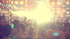 People at concert and light flares slow motion Stock Footage