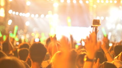 People making video with action camera at concert 4k UHD (3840x2160) Stock Footage
