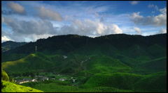 FULL HD Time lapse of clouds and tea plantation at Cameron Highland, Malaysia. Stock Footage