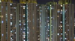 High density apartment block at night in Hong Kong , Time lapse - stock footage