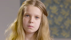 Portrait of a young girl with serious expression and then smiling Stock Footage