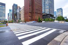 Traffic on road intersection in downtown of tokyo Stock Photos