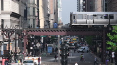 4K Chicago L Train Crosses Over Busy Street Stock Footage