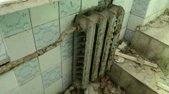 Radiator heating in the toilet of the abandoned house. Stock Footage