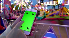 Close up of female using smart phone with a green screen at the West Coast Am Stock Footage