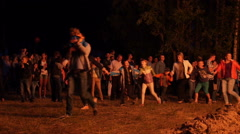 People dance around the fire Stock Footage