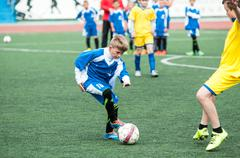 Orenburg, Russia - 1 June 2016: The boys play football Kuvituskuvat