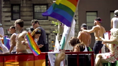 Gay Pride float and rainbow flags - LGBT Parade in NYC  Stock Footage