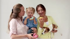 Family, three women eating donuts and dog Stock Footage
