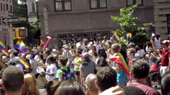 LGBT Pride March - Gay Parade with rainbow flags waving in NYC Stock Footage