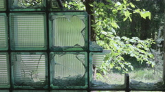 Broken glass in the window. Smooth and slow dolly shot. - stock footage