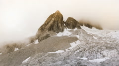 Jade Dragon Snow Mountain in summer, Lijiang,Yunnan China. Panning Left Stock Footage
