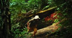 Tourist traveler trekking in dense tropical rainforest. Nature adventure video - stock footage