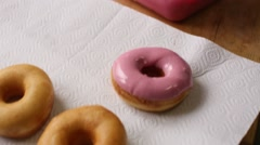 Chef hand cooks and glazed pink donut in chocolate Stock Footage