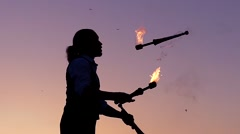 Fantastic Show at Sunset. the Circus Performer is Juggling Clubs on Fire.. Slow Stock Footage