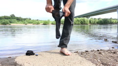 Good man dress socks and shoes in the background of the river and bridge Stock Footage