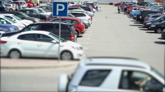 Parking is in front of the hypermarket with buyers - stock footage
