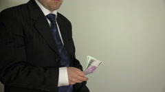 Man take euro money from leather wallet and put in suit pocket. 4K Stock Footage