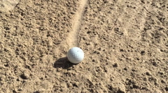 Explosive golf bunker shot Stock Footage