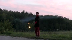 Fire Show at Sunset. Man Used Poi to Making Beautiful Effects. Slow Motion. - stock footage