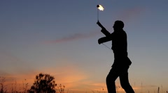 Amazing Fire Show at Sunset. Circus Man Working With Fire Poi. Slow Motion. - stock footage