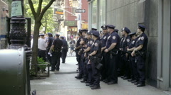 large group of NYPD police officers in Greenwich Village NYC - stock footage