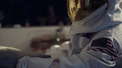 4K Astronaut relaxing in apartment looking at view of planet earth Stock Footage