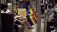 LGBT rainbow flags on subway train interior - Gay Pride in NYC Stock Footage