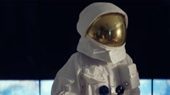 4K Astronaut looking through window at view of planet earth Stock Footage