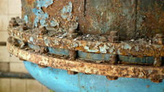 Rusted nuts of the boiler in the abandoned factory. Smooth and slow dolly shot. Stock Footage
