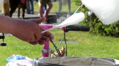 Preparation of Cotton Candy in Slow Motion. the Action Takes Place in the Park. Stock Footage