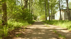 Pathway in the park. Smooth and slow steady cam shot. Clean and bright daytime. - stock footage