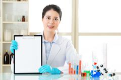 Asian female scientist distressed to recording her research data - stock photo