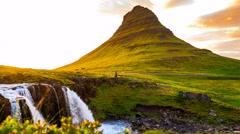 Kirkjufell mountain and Kirkjufell waterfalls in West Iceland Stock Footage