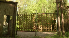 Gates to the abandoned kids camping. Smooth and slow steady cam shot. Stock Footage